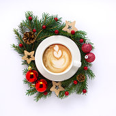 Creative concept holiday celebration photo of christmas toys balls decoration with coffee cup on white background.