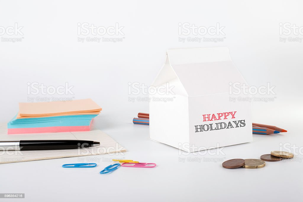 Happy Holidays. White office desk with a milk pack royalty-free stock photo