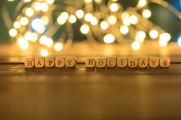 happy holidays written on a rustic wooden panel. - happy holidays stock pictures, royalty-free photos & images