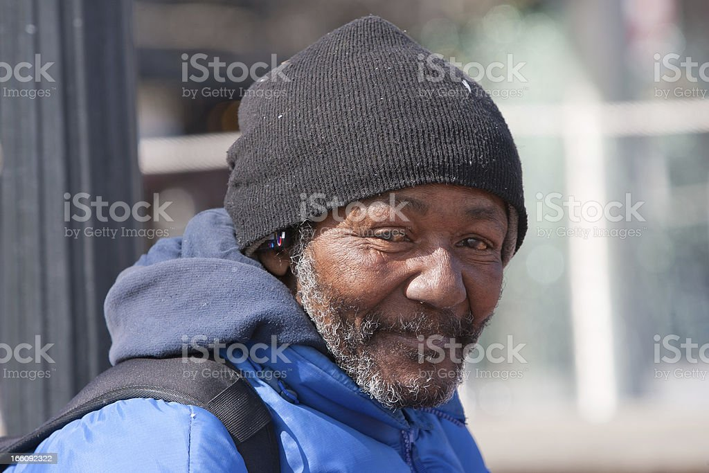 Happy homeless african american man stock photo