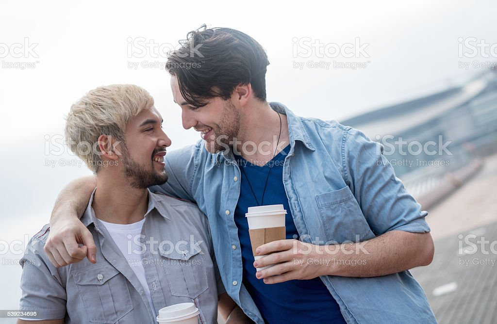 Happy homosexual couple on a date royalty-free stock photo