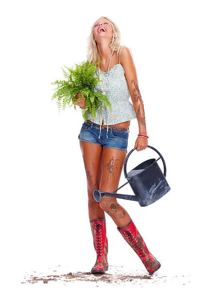 Happy hot Blondes Fotomodell als Gärtner auf Weiß – Foto