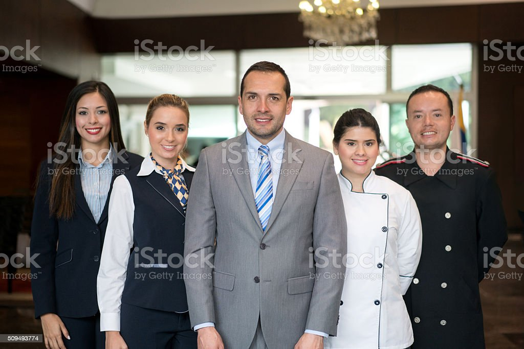 Happy hotel staff stock photo