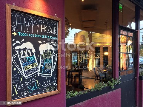 Buenos Aires, Argentina - October 31, 2019: Sidewalk cafe offering happy hour every day in Palermo district. This neighborhood is well knows for its huge offer of bars and restaurants