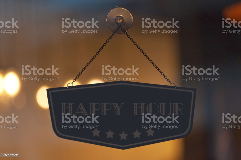 Happy Hour sign in a window stock photo