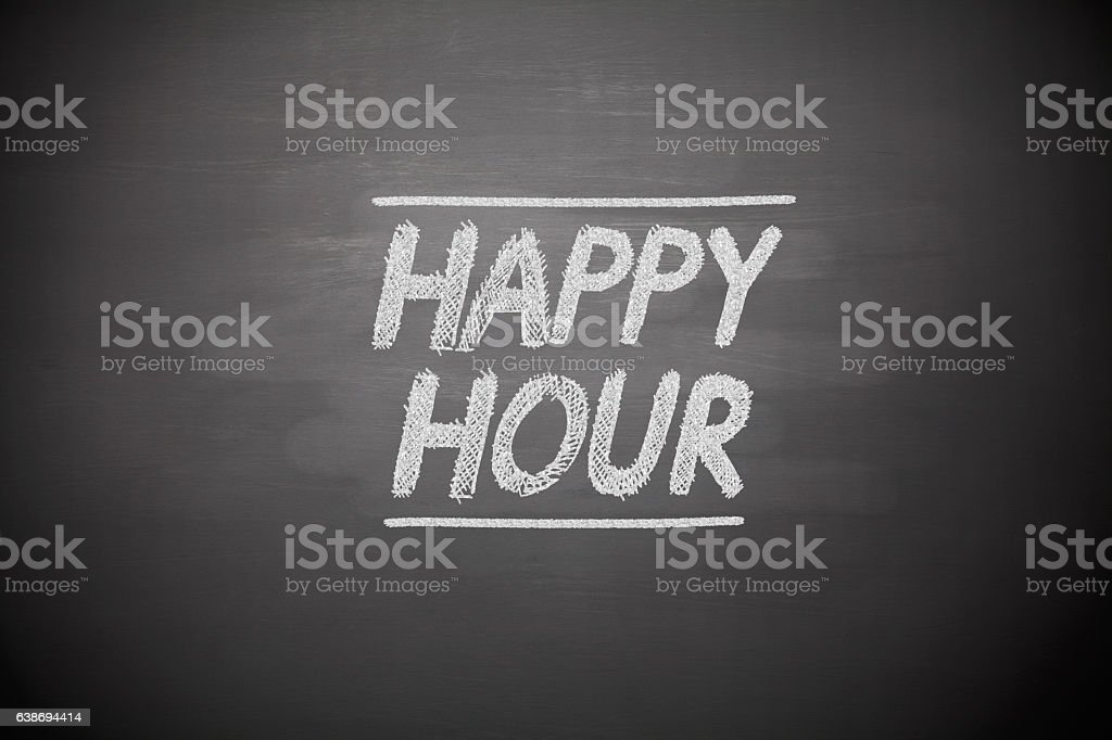 Happy hour sign on chalkboard stock photo