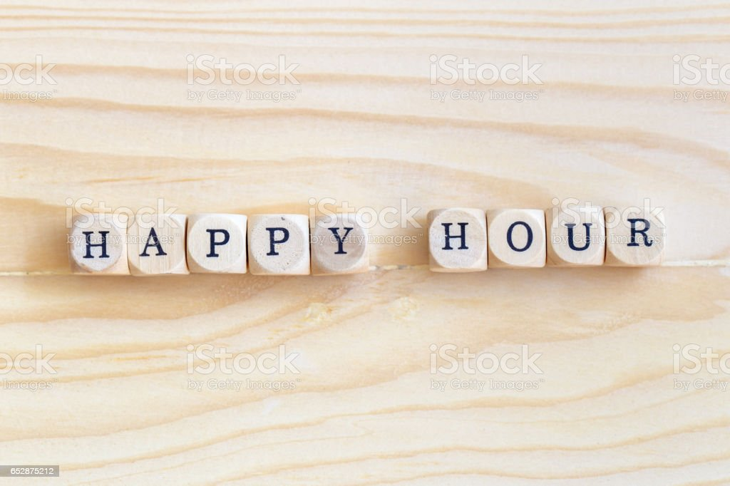 Happy Hour, Top views word made from wooden letters on the table stock photo