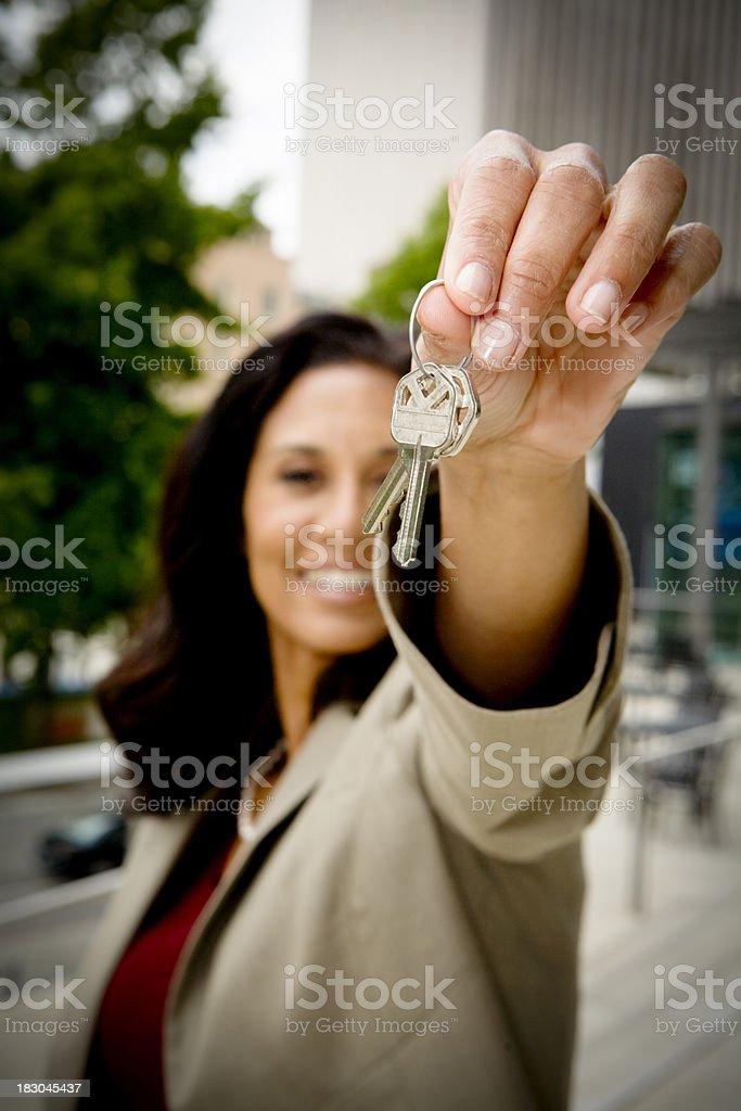 Happy house keyholder stock photo