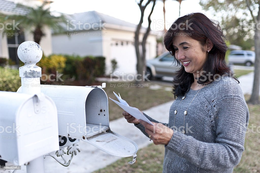 Happy Housewife receiving the mail stock photo