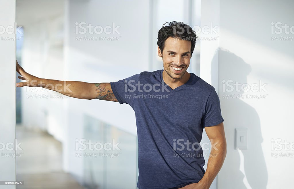Happy hunk at home stock photo