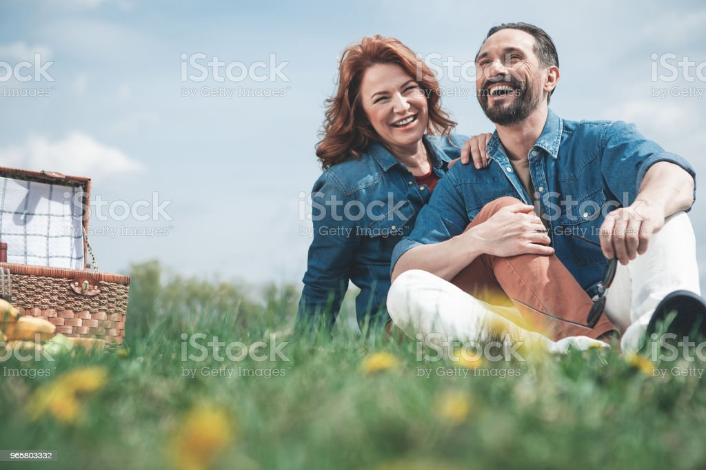 Happy husband and wife bonding to each other on meadow - Royalty-free Adult Stock Photo