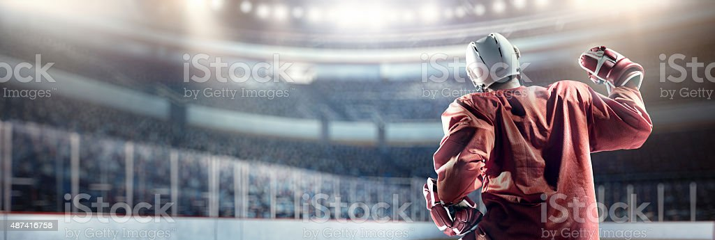 Happy ice hockey player stock photo
