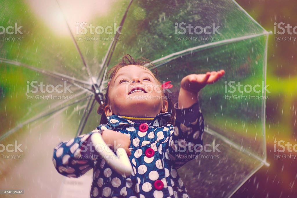 Happy in rain stock photo