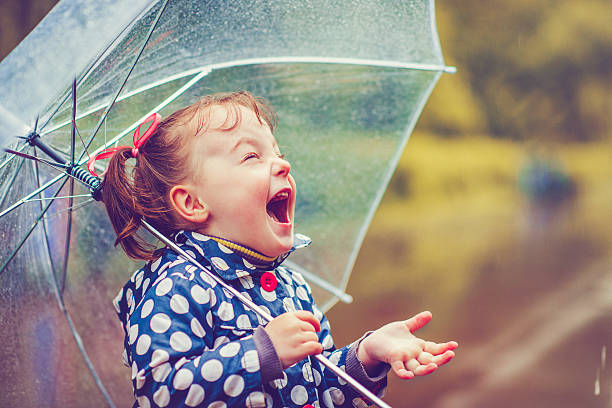 happy in rain - rain stock photos and pictures