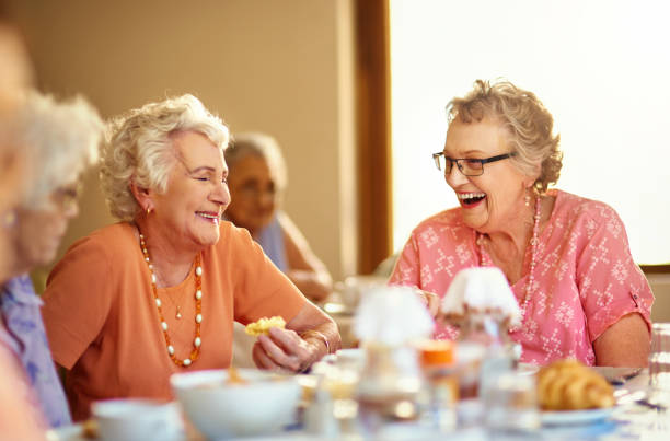 happy in the home - elderly group stock photos and pictures