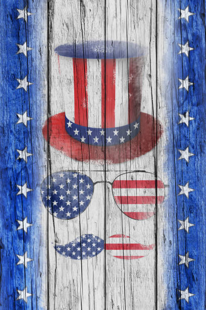 happy independence day. uncle sam's hat, mustaches and sunglasses on rustic wooden surface - fourth of july стоковые фото и изображения