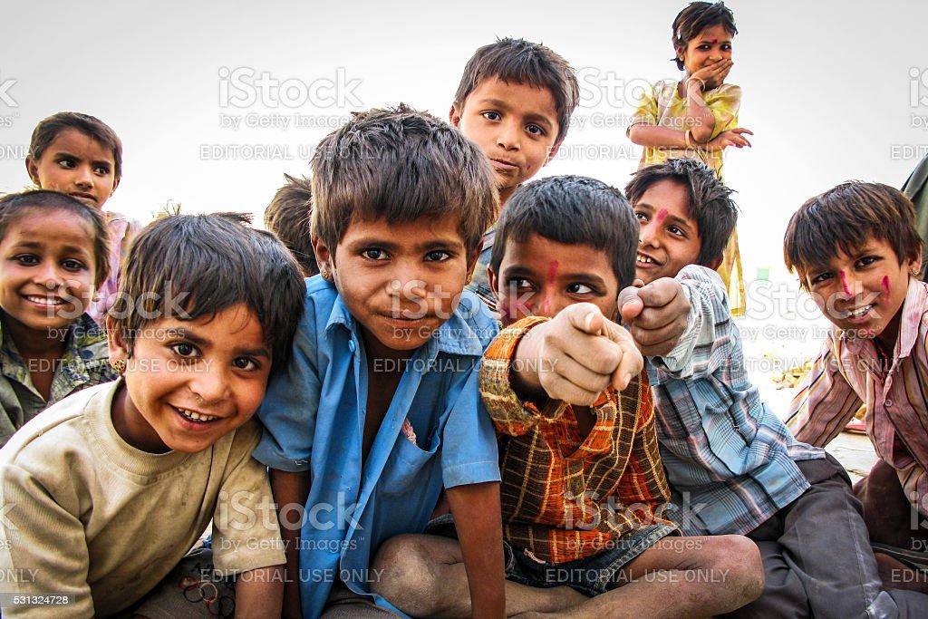 Happy Indian Children at Desert Village in Jaisalmer, Rajasthan, India stock photo
