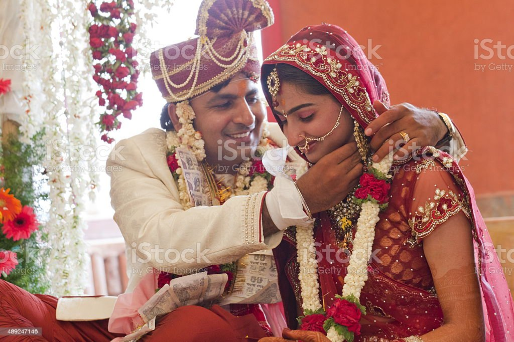Happy Indian couple at their wedding. stock photo