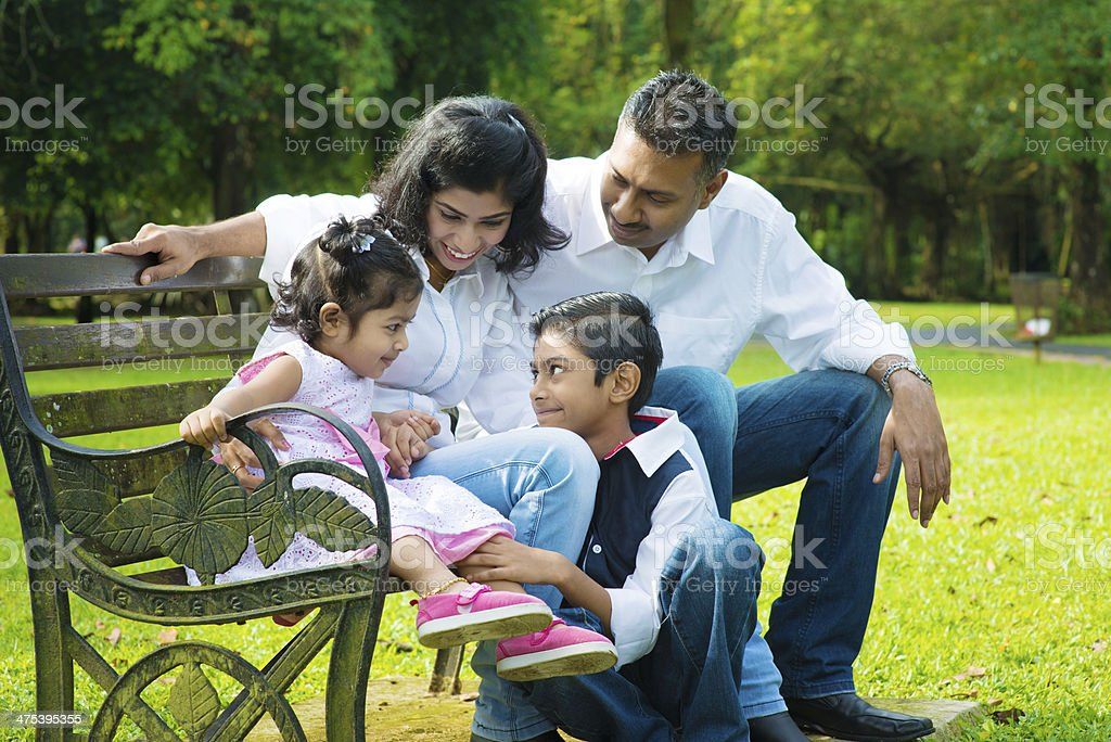 Happy Indian family candid stock photo