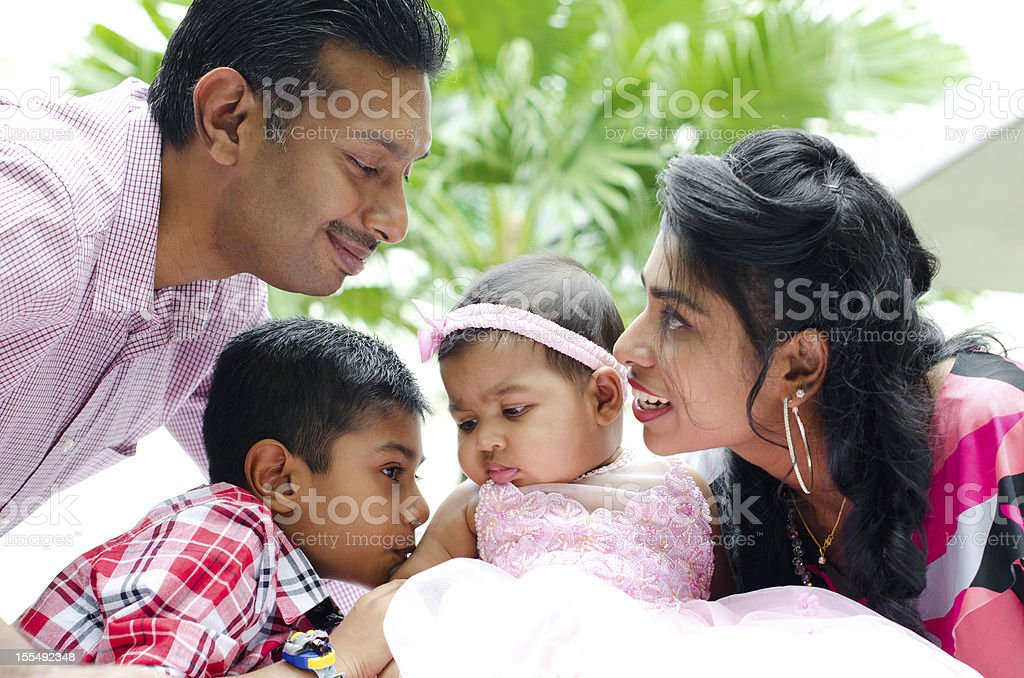 Happy Indian family with two children stock photo