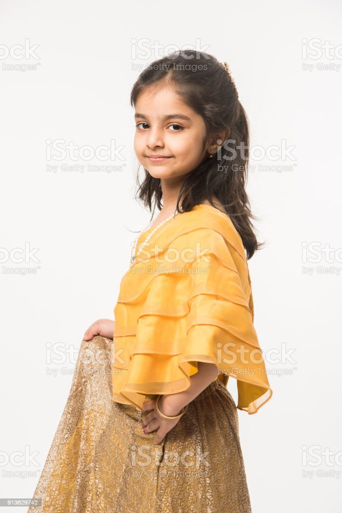c4b9428d8412d happy Indian girl child in ethnic wear or traditional wear, holding gift  boxes or posing