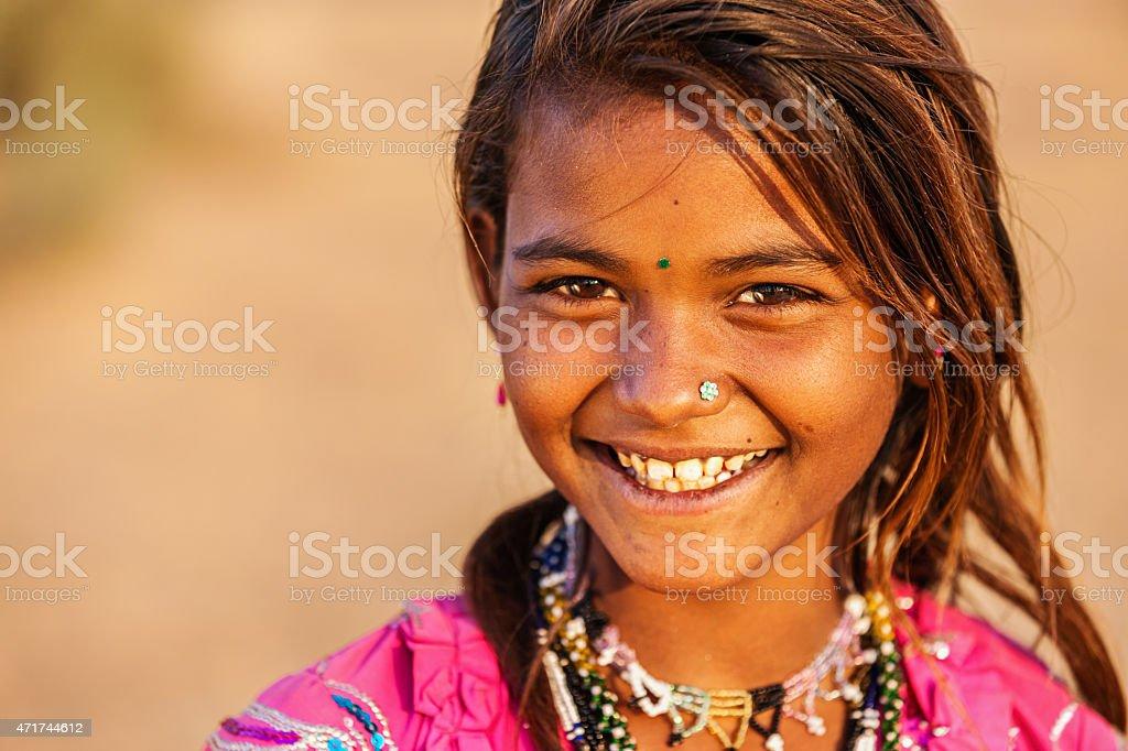 Happy Indian girl in desert village, India stock photo