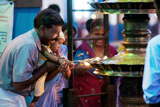 Happy indian man with little child in the temple stock photo