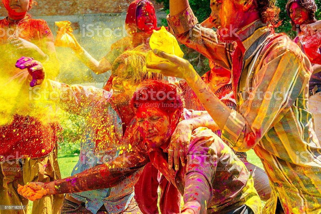 Happy indian people celebrating Holi Festival stock photo