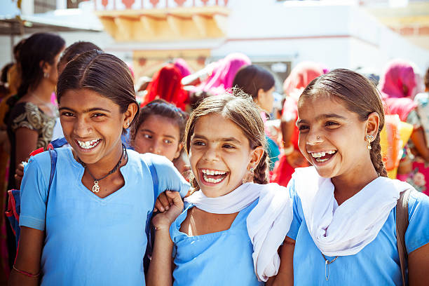 happy indian school girls - village stock photos and pictures