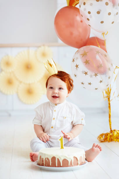 happy infant baby boy celebrating his first birthday happy infant baby boy celebrating his first birthday first birthday stock pictures, royalty-free photos & images