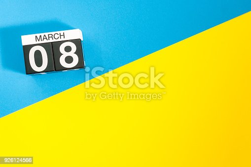 968874704istockphoto Happy International Women's Days. March 8th. Day 8 of month, calendar on yellow and blue background. Empty space for text. 926124566