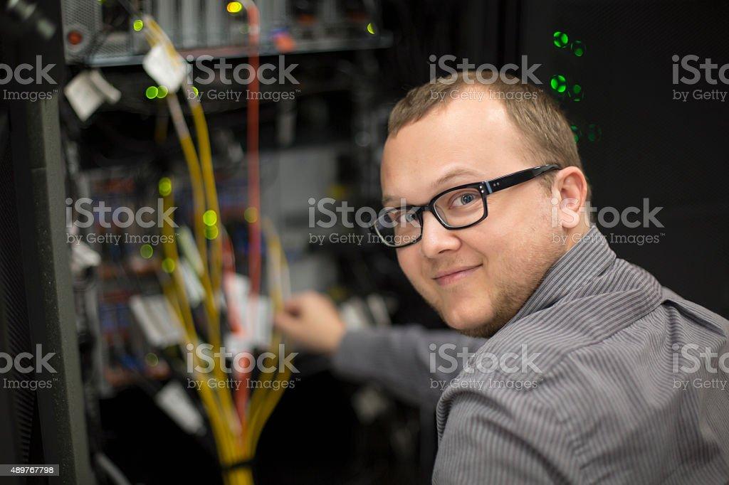 Happy IT Tech working on server