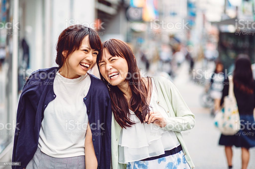 Happy japanese girl friends outdoors in japan stock photo for Friend in japanese