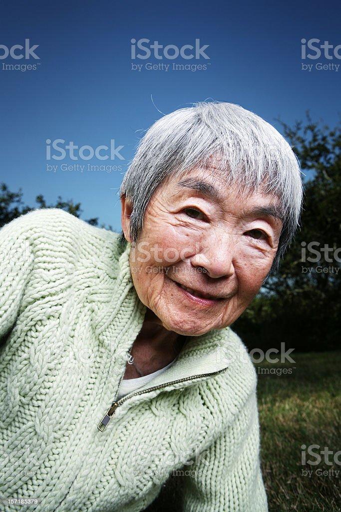 Happy Japanese Grandma at Sunset Outside royalty-free stock photo