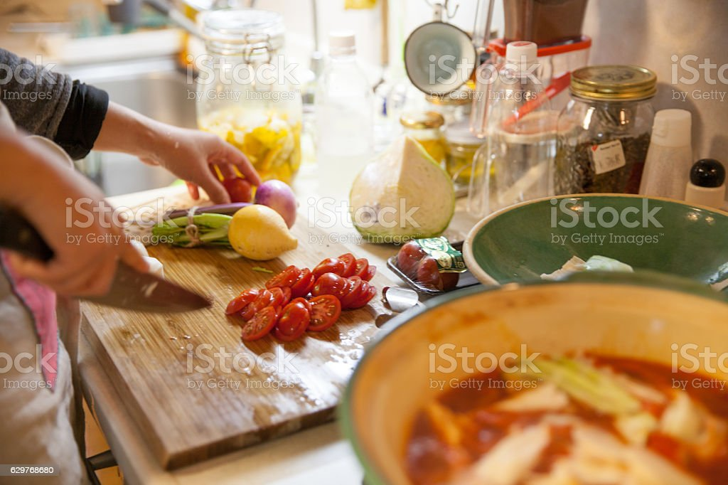 Happy Japanese mother cooking for family and friends stock photo