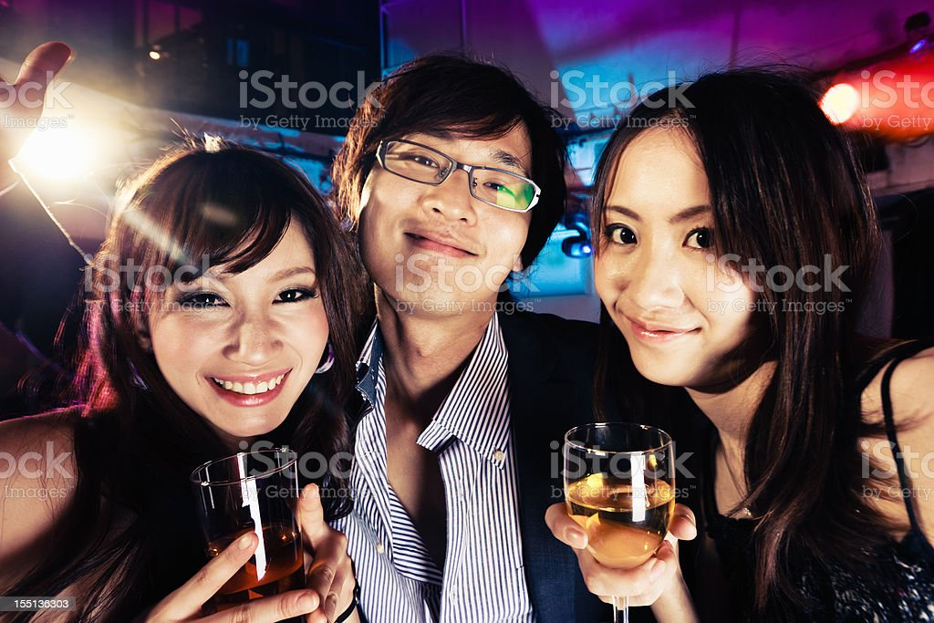 Happy Japanese Youths Party and Drink in Tokyo Nightclub royalty-free stock photo
