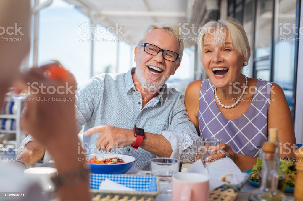 Happy joyful elderly people being in a great mood stock photo
