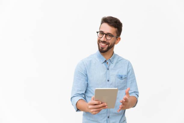 Happy joyful guy with tablet getting good news stock photo