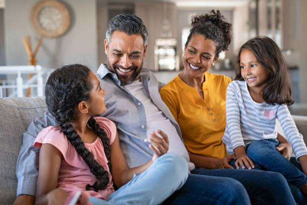 Happy joyful mixed race family having fun together stock photo