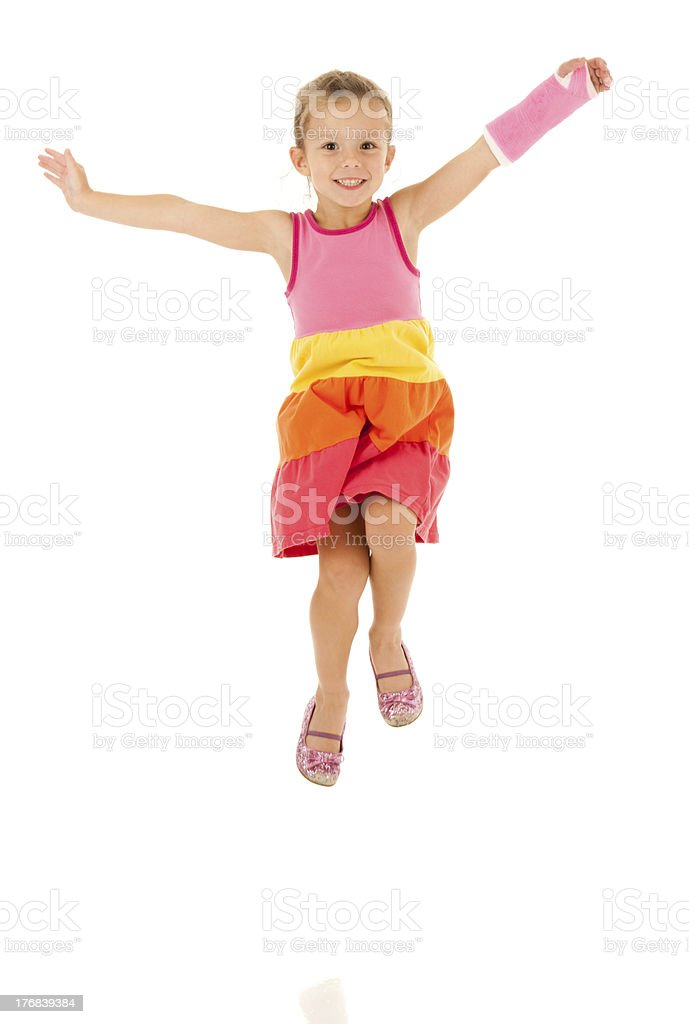 Happy, Jumping Girl with Cast on Broken Arm stock photo