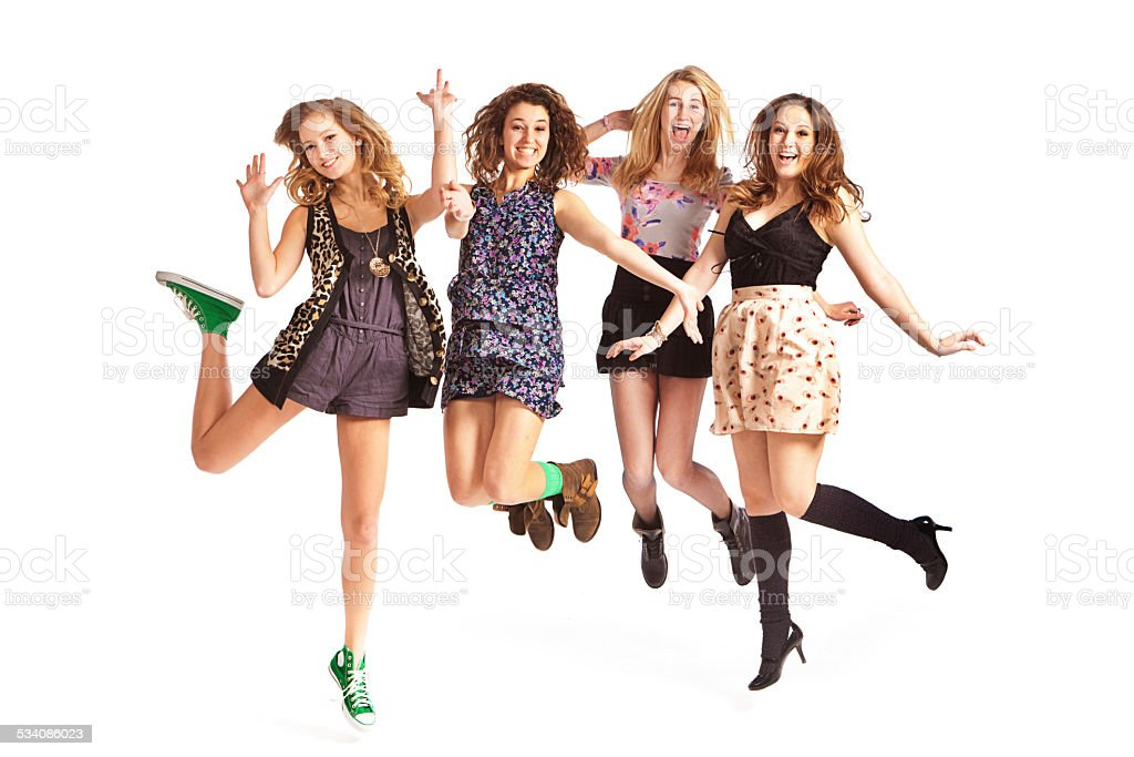 Happy Jumping Teen Girls on White Background stock photo