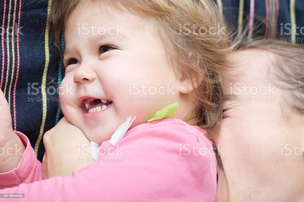 Happy kid and dad having fun stock photo