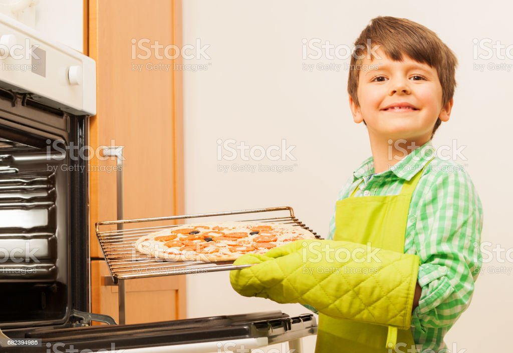 Happy kid boy with fresh-baked pizza royalty-free stock photo