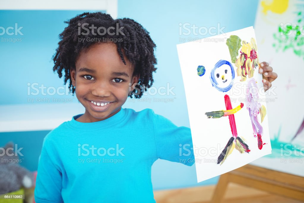 Happy kid enjoying arts and crafts painting stock photo