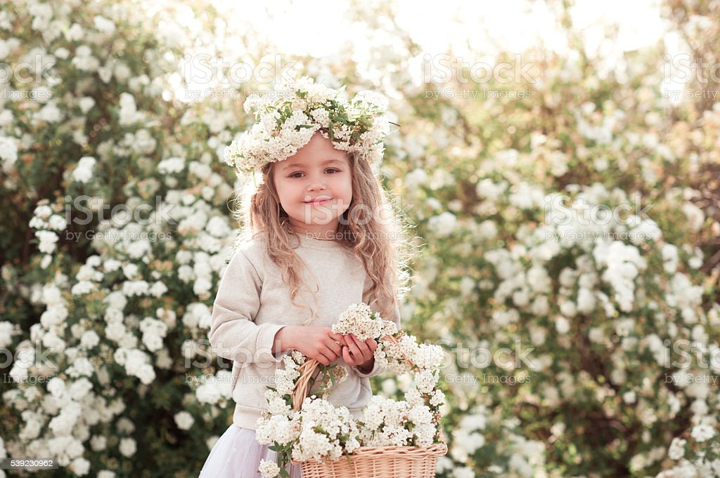 Happy kid girl holding flowers royalty-free stock photo