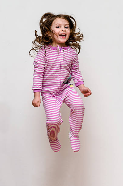 Happy Kid Pajama Jumping stock photo