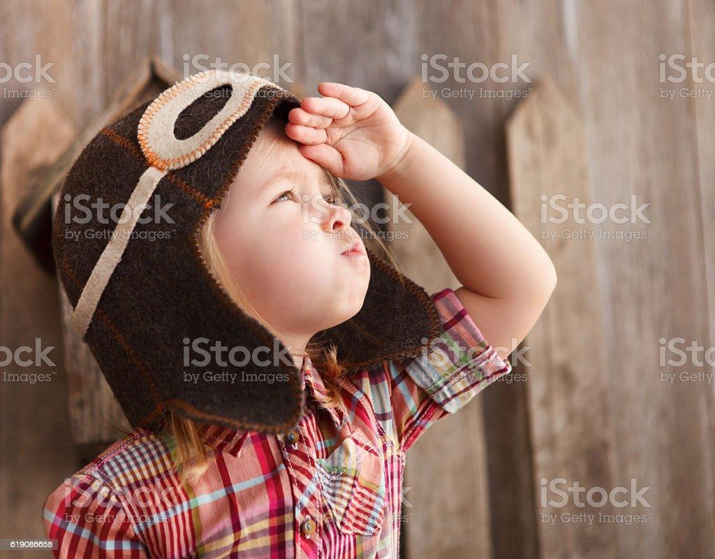 Happy kid playingin pilot helmet stock photo
