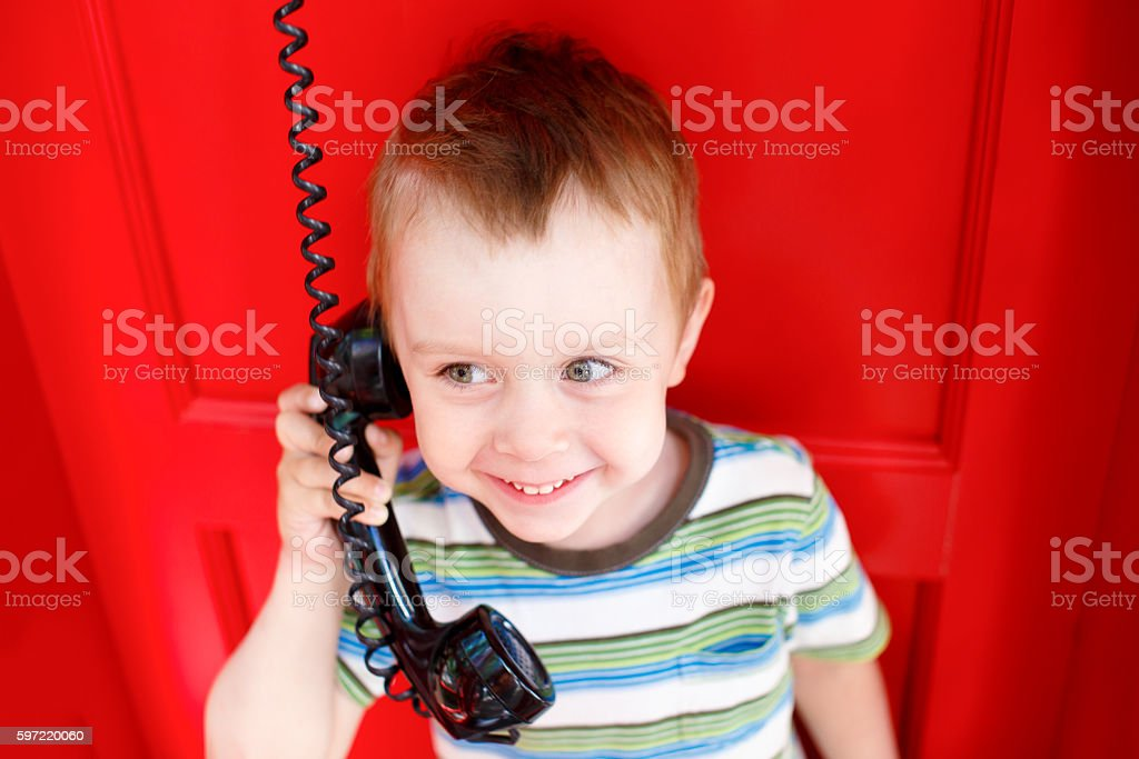 happy kid talking on the phone stock photo