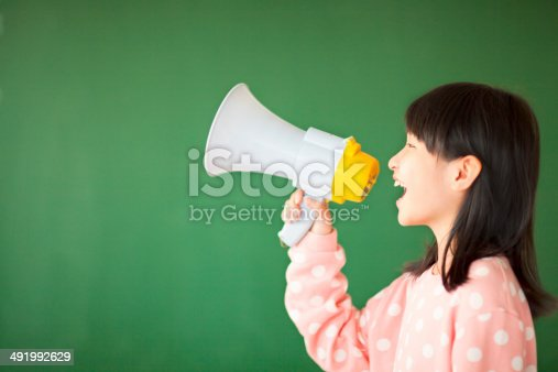 istock happy kid using a megaphone to shout 491992629