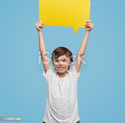 465462550istockphoto Happy kid with paper speech bubble 1149081566